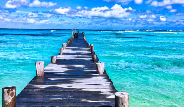 wooden pier over a blue sea