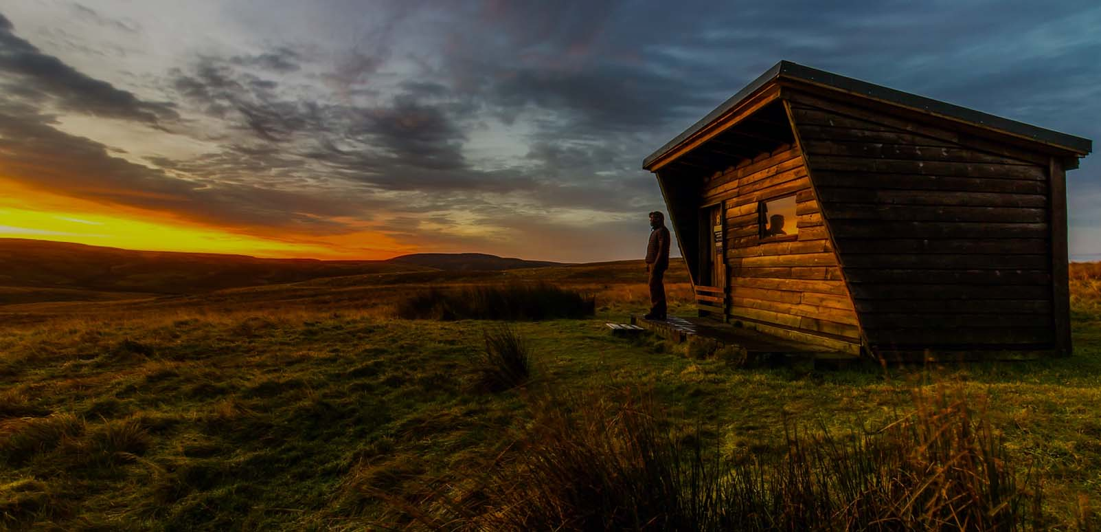 wooden shack in the wilderness
