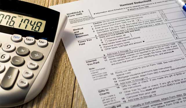 tax form with a calculator next to