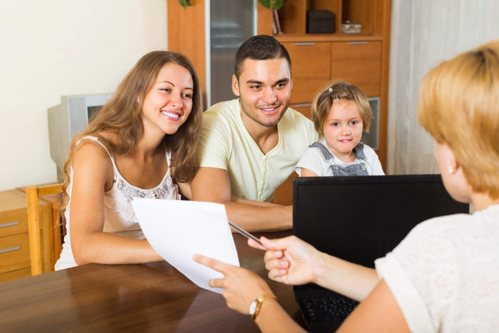 A family is talking to a life insurance agent